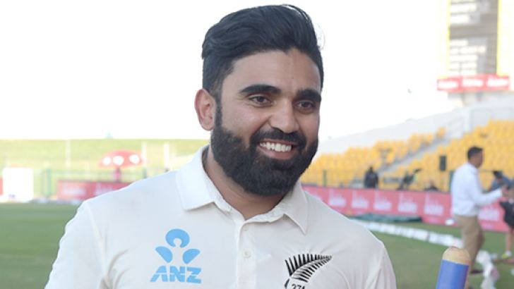 New Zealand cricketer Ajaz Patel holds a ball and wicket as he celebrates after beating Pakistan in the first Test cricket match between Pakistan and New Zealand at the Sheikh Zayed International Cricket Stadium in Abu Dhabi on November 19. AFP