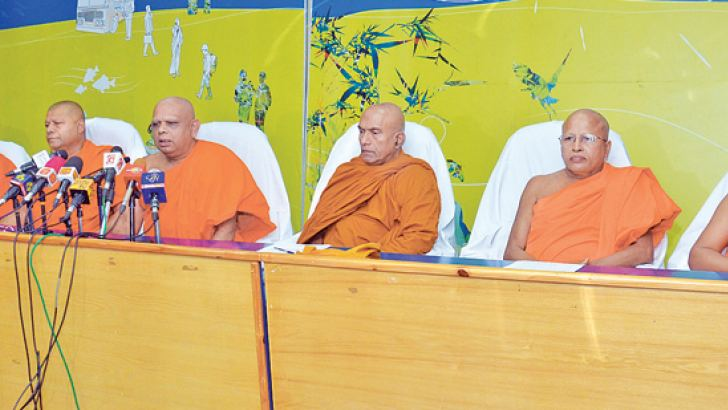 A media conference organised by leading monks of Sri Lanka was held at the SEMA building in Colombo yesterday, to express their views on the current political impasse in the country. Picture shows Ven. Prof. Gallaalle  Sumanasiri Nayaka Thera, Vice Chancellor of the Buddhist and Pali University, Ven. Kegalle Rathanasaara Thera,  incumbent Monk of the Veherahena Temple, Matara, Ven.Hegoda Vipassi Thera, Director of the Paramadhamma  Research Centre, Ratmalana, Ven. Kotapola Amarakeerthi Thera, Patron of the