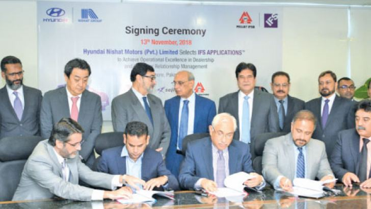 Hassan Mansha, Chief Executive Officer Hyundai Nishat Motors Co Ltd, Irfan Aqueel, Chief Executive Office Millat Tractors Ltd and Shiraz Lye, Managing Director/ Vice President Sales IFS South Asia at the agreement signing ceremony
