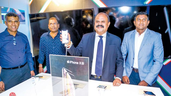 Launch of the latest Apple iPhone XR, XS and XS Max by P G Kumarasinghe Sirisena Chairman, Sri Lanka Telecom & Mobitel. Also present were (from left)  Namal Ratnayake Senior General Manager, Legal, Regulatory Affairs & NII, Rasantha Hettithanthrige, Senior General Manager, Engineering & Operations and Isuru Dissanayake, Senior General Marketing of Mobitel.