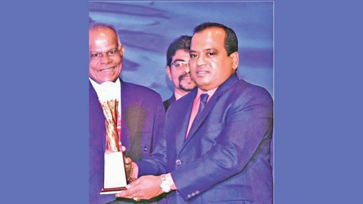 E.K. Anil De Silva, Chairman of New Alutec Group of Companies receiving the award