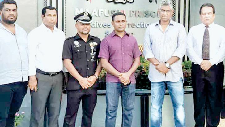 Minister Faiszer Musthapha (second from right) with Lahiru Madusanka Manikkandura (standing next to him) outside the Maafushi Prison in the Maldives.