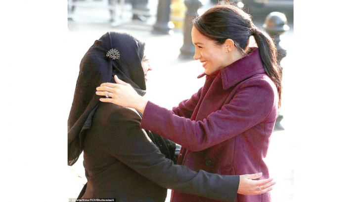 Meghan hugs Zaheera Sufyaan, who is part of the Hubb Community Kitchen in West London.