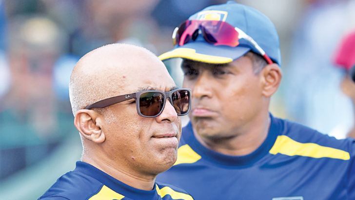 BITTER PILL TO SWALLOW: Head coach Chandika Hathurusingha and batting coach Thilan Samaraweera watch the capitulation of the Lankan second innings against England in the third Test at the SSC. AFP