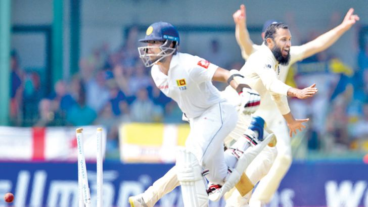 THE TURNING POINT: England's Adil Rashid celebrates the run out of Sri Lankan batsman Kusal Mendis for 86 via a direct hit from Jack Leach (not in picture) on the fourth day of the third and final Test at the SSC grounds yesterday. AFP
