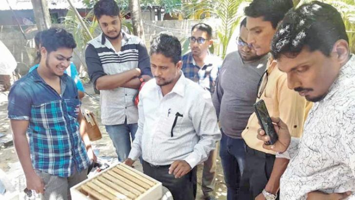Residents being trained for bee-keeping. Picture by I.L.M. Rizan, Addalaichenai Central Corr.