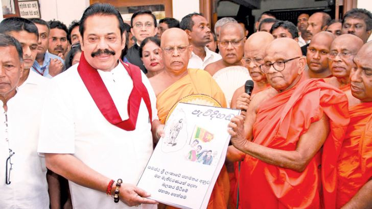 A petition containing 5 million signatures was handed over to MP Mahinda Rajapaksa by the Ven. Muruththettuwe Ananda Thera at a special function held at the Abhayaramaya in Narahenpita yesterday afternoon. Picture by Dushmantha Mayadunne
