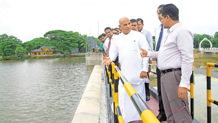 Northern Province Governor Reginald Cooray speaking to officials at the Iranamadu reservoir.