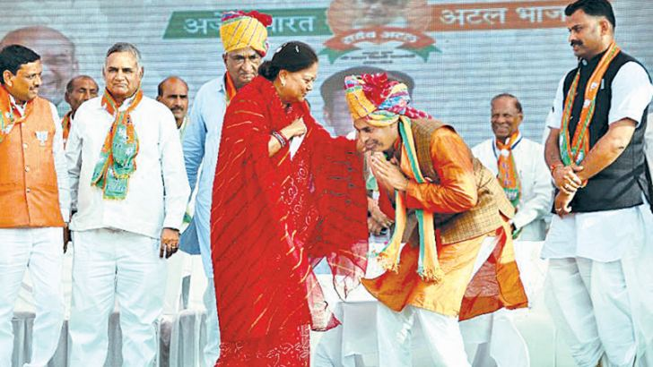 "Vasundhara Raje (C), Rajasthan's Chief Minister and a charismatic ""Maharani"" or female Maharaja swept to power in a landslide in 2013."