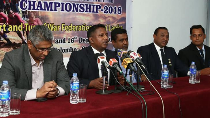 President of Tug of War Federation of Sri Lanka Janaka Ranasinghe speaking at the press conference. Former Minister of Sports Faiszer Mustapha and director general Dhammika Muthugala are also in the photograph.