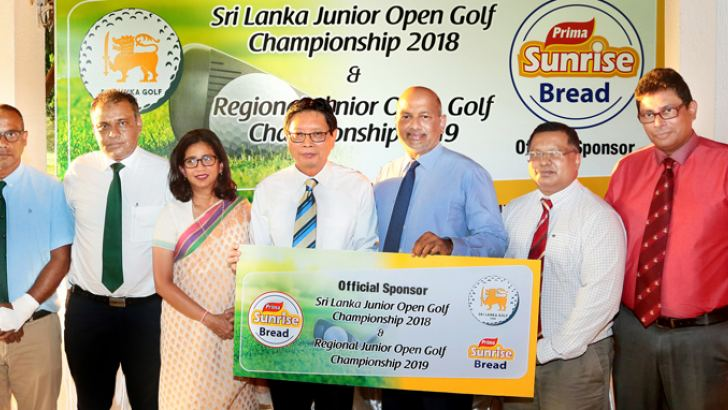 A press conference in connection with the Sri Lanka Junior Open Golf Championship sponsored by Prima Sunrise Bread of Prima Ceylon was held at the Royal Colombo Golf Club on Tuesday. Here Shun Tien Shing – General Manager, Ceylon AgroIndustries Ltd, is handing over the sponsorship cheque to (Retd) Air Chief Marshal Harsha Abeywickrama - President of Sri Lanka Golf Union, while (From Left) Shiran Fernando - Vice Captain RCGC, Firaz Hameed - Captain ofVictoria Golf Club Nuwara Eliya, Mrs. Niloo Jayathilaka -