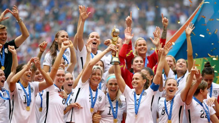 USA players hold aloft the World Cup trophy after winning the 2015 tournament in Canada. AFP