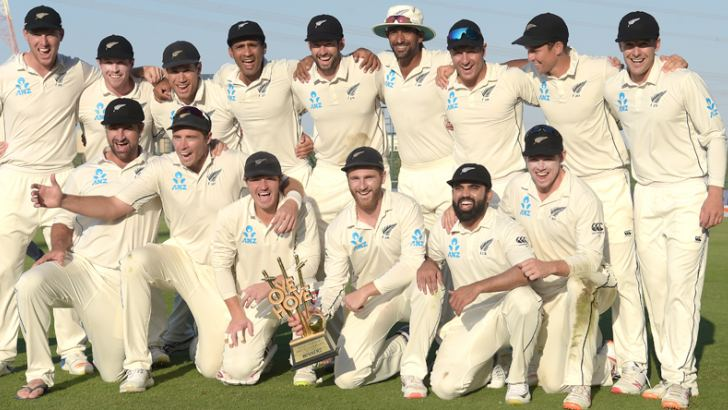 New Zealand cricketers pose with the winner's trophy following the third and final Test cricket match against Pakistan at the Sheikh Zayed International Cricket Stadium in Abu Dhabi on Friday. AFP