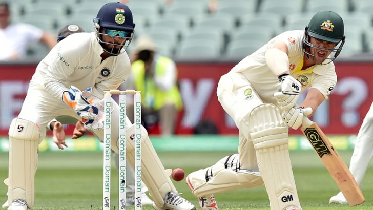 Travis Head (C) playing a shot as Indian wicketkeeper Rishabh Pant (L) looks on during day two of the first Test match at the Adelaide Oval on Friday. AFP