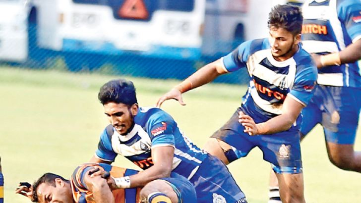 An Army Player is brought down by a Navy Player in their Dialog 'A' Division League rugby match played at Ratmalana yesterday which Navy won 29/14.Picture by Samantha Weerasiri