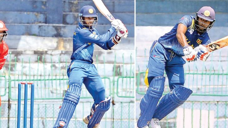 Sri Lanka's Hasitha Boyagoda who top scored with 80 (on left) and Kamindu Mendis (75) shared a century partnership against Oman at the R Premadasa Stadium yesterday. (Pic by Saman Mendis).