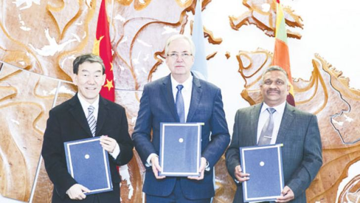 Daniel Gustafson, of FAO, Niu Dun, Ambassador and Permanent Representative of China to FAO and K.D.S. Ruwanchandra, Secretary of the Ministry of Agriculture of Sri Lanka after signing the agreement