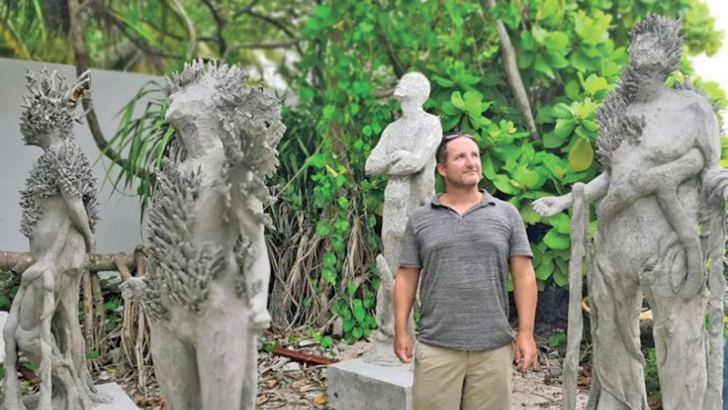 Jason deCaires Taylor with some of his creations