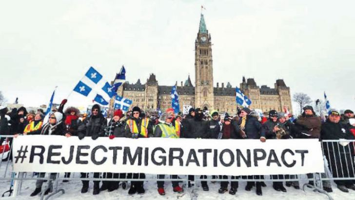Right-wing protesters rally against the UN international pact on migration at Parliament Hill in Ottawa. - AFP