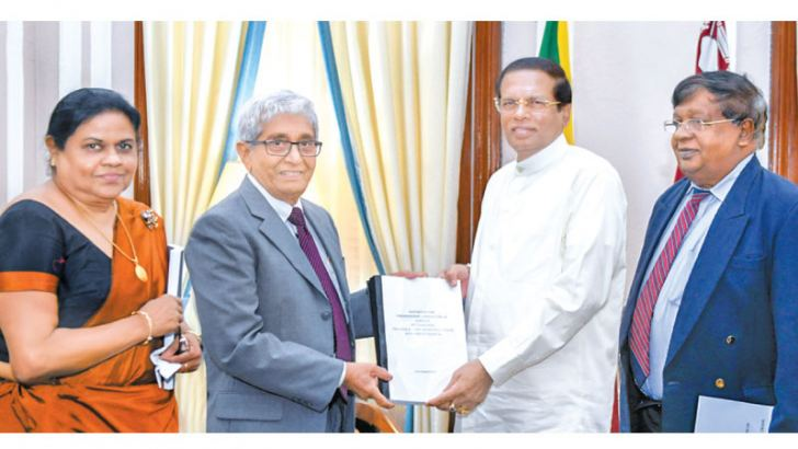 Committee Chairman and former Colombo University Vice Chancellor and Professor of  Economics Emeritus W.D. Lakshman presenting the Committee report on Singapore-Lanka FTA to President Maithripala Sirisena. Picture by Sadaruwan Amarasinghe