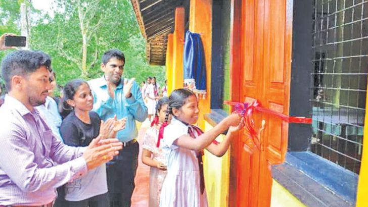 A student opening the science laboratory.