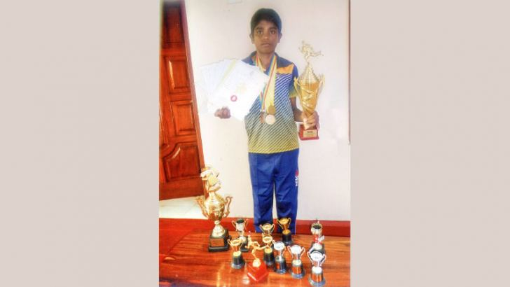 Thevindu Sandil with his trophies