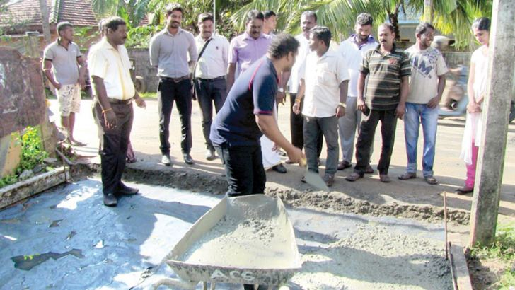 The Batticaloa mayor and officials inspect the road work.