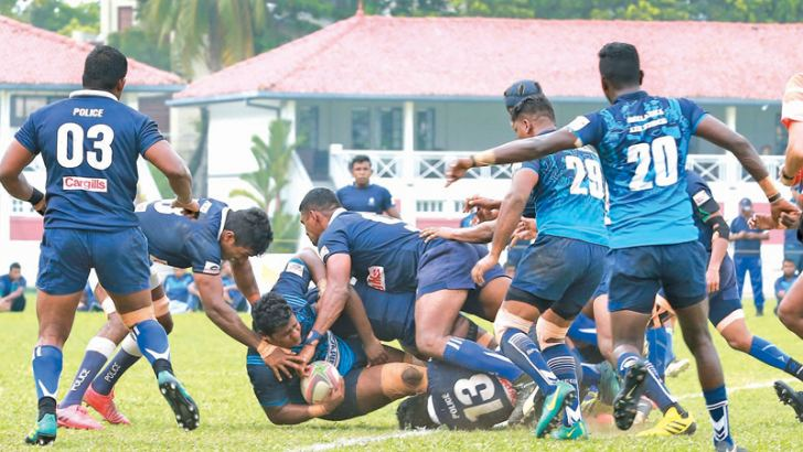 Action from the Police-Air Force match. Picture by Malan Karunarathne.