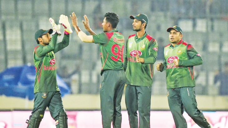 Bangladesh cricketer Mustafizur Rahman (2L) celebrates with his teammates after the dismissal of West Indies cricketer Marlon Samuels during the second one-day international (ODI) between Bangladesh and West Indies at the Sher-e-Bangla National  Cricket Stadium in Dhaka  on December 11.