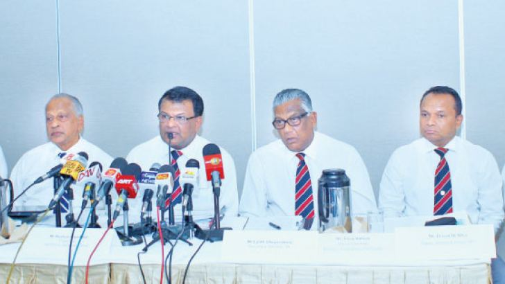 Planters Association Ceylon spokesman, Roshan Rajadurai and other officials at the Press conference yesterday. Picture by Saliya Rupasinghe