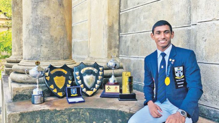 With some of his  trophies and medals