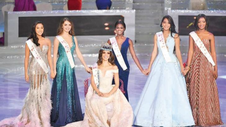 Miss Mexico Vanessa Ponce de Leon reacts after winning the 68th Miss World contest final, with runner-up Miss Thailand Nicolene Pichapa Limsnukan (L), Miss Belarus Maria Vasilevich (2L), Miss Jamaica Kadijah Robinson (3R), Miss Panama Solaris Barba (2R) and Miss Uganda Quiin Abenakyo (R) in Sanya on the tropical Chinese island of Hainan