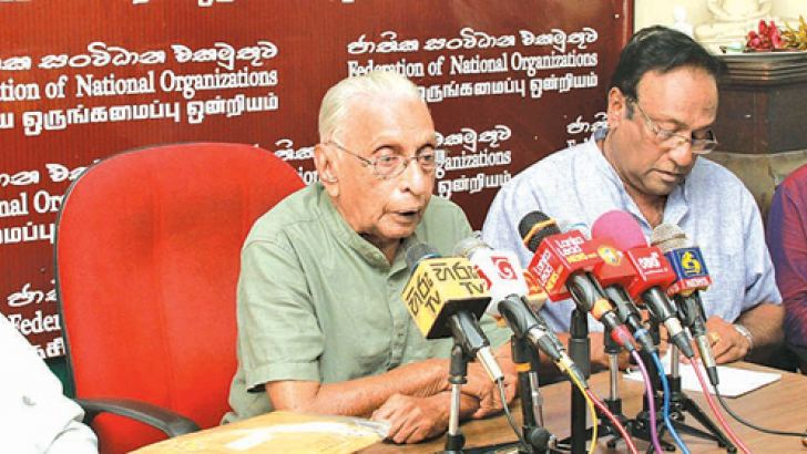 Federation of National Organizations Convener Dr Gunadasa Amarasekara speaking at the press conference yesterday. Attorney Kalyananda Thiranagama, Dr. Wasantha Bandara and retired Rear Admiral Sarath Weerasekara were present. Picture by Kelum Liyanage