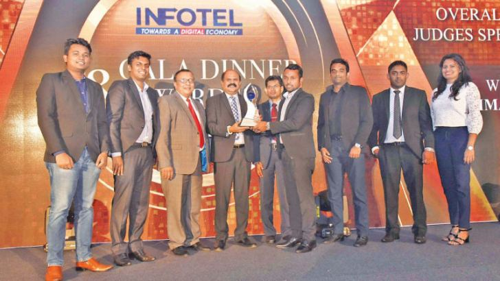 Arimac Digital team receiving the overall winner award at the INFOTEL Awards 2018