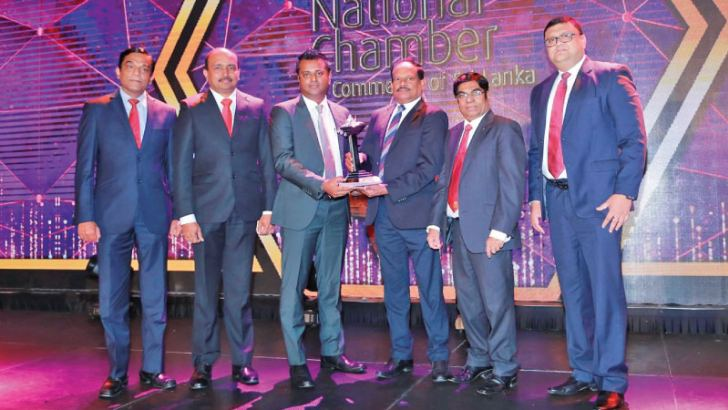 Browns Group Chief Operating Officer Danesh Abeyratne together with Group Chief Financial Officer T. Sanakan, Chief Process Officer C.N. Rathakrishnan, and Senior Vice President  Group Human Resources Paduma Subasinghe accepting the award.