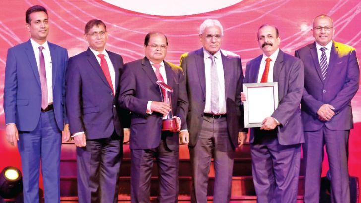 Commercial Bank Chairman Dharma Dheerasinghe and Deputy Chairman Preethi Jayawardena with the presentation party headed by Central Bank Governor Dr Indrajit Coomaraswamy at the 2018 CA Sri Lanka Annual Report Awards.