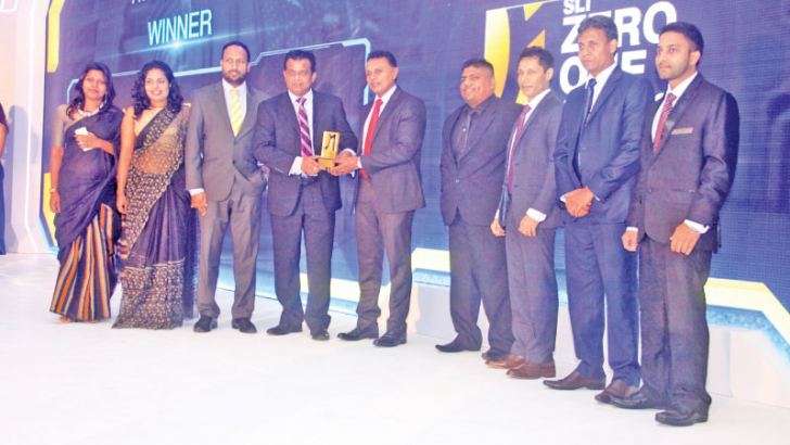 Here officials of the ICT Agency of Sri Lanka receiving the award for 'the best Digital enabled product/Service category at the event. Picture by Chaminda Niroshana