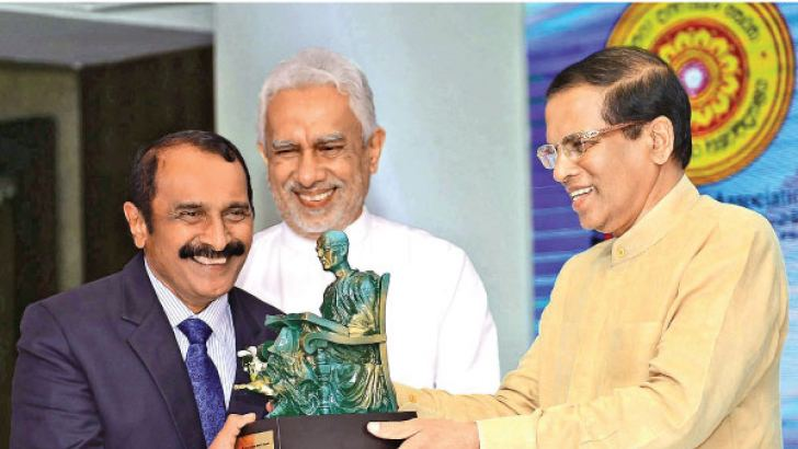 Founder JMC, J.M.U.B. Jayasekera receiving an award from President Maithripala Sirisena