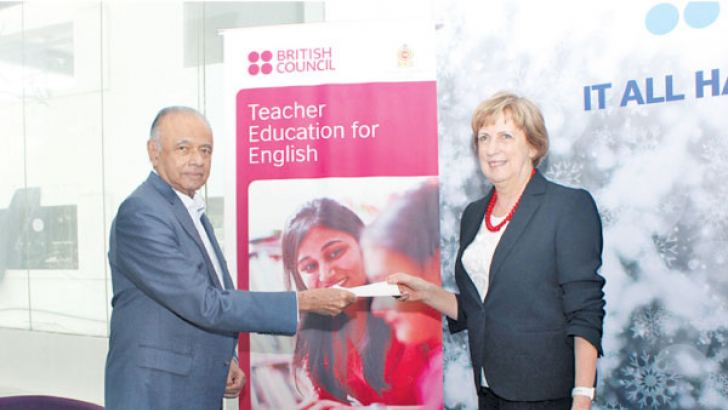 Ricky Mendis handing over the final tranche of the payment to Gill Caldicott, Country Director British Council Sri Lanka