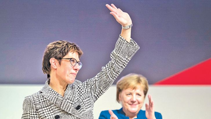 Annegret Kramp-Karrenbauer waves to delegates at a national conference of the CDU on December 7, 2018 in Hamburg.