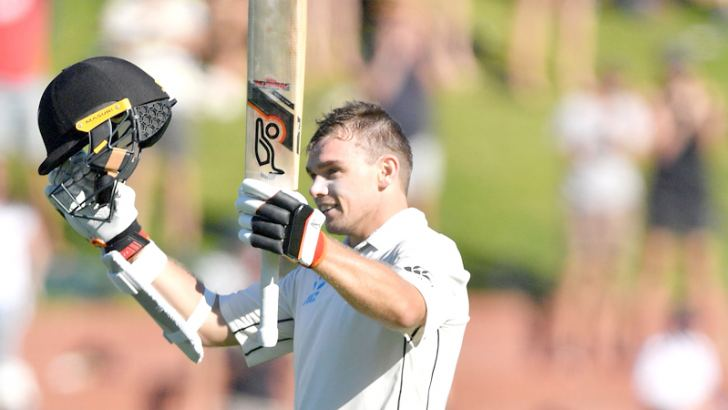 New Zealand's Tom Latham celebrates his century during day two of the first Test cricket match against Sri Lanka at the Basin Reserve in Wellington on Sunday. AFP