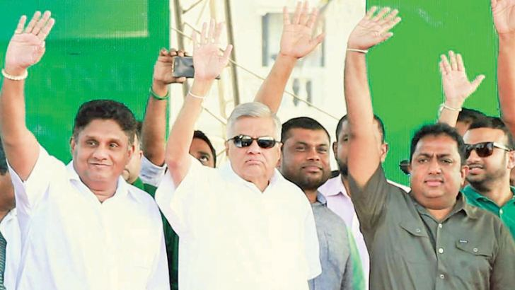 Prime Minister Ranil Wickremesinghe, UNP Deputy Leader Sajith Premadasa and UNP General Secretary Akila Viraj Kariyawasam greeting the crowd at the UNP victory rally at Galle Face Green in Colombo yesterday. Pictures by Malan Karubnaratne