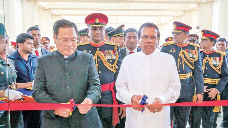President Maithripala Sirisena along with the Chinese Ambassador cut the ribbon to declare open the auditorium.