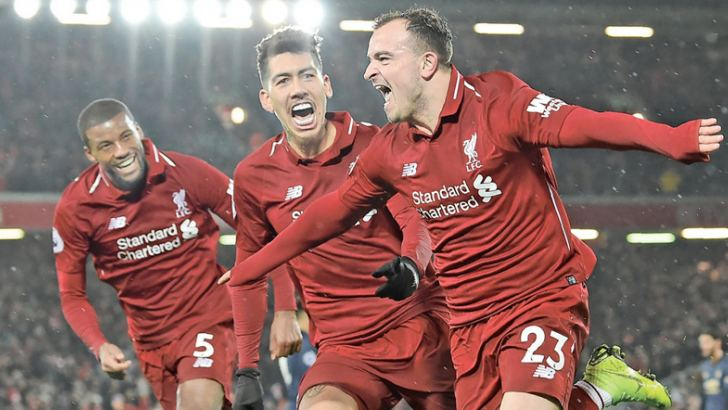 Liverpool's Xherdan Shaqiri (R) celebrating with teammates after scoring their third goal against Manchester United. AFP