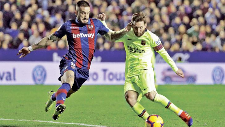 Lionel Messi taking on the defender Erick Cabaco in Barcelona's 5-0 win away to Levante. AFP