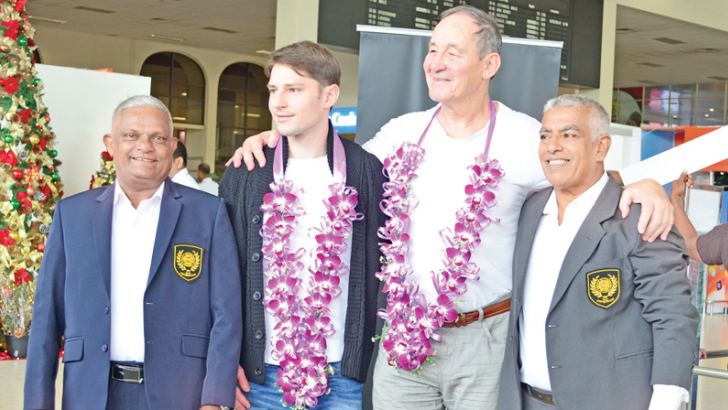 Gunter Mohr (second from right) is seen here with his son and K.A. Piyaratne (extreme left) and W.A. Tudor Perera (extreme right)
