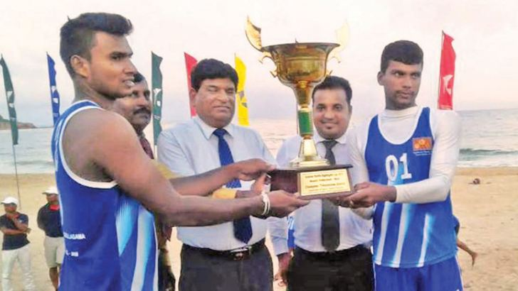 The Secretary to the Eastern Province Governors' J.S.D.M.Asanka Abeywardena giving away the trophy to the skipper of the Kantale team.