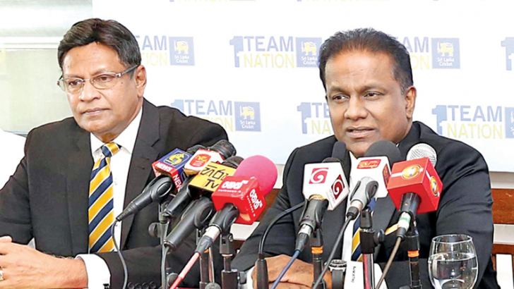 Thilanga Sumathipala speaking at the press conference held at the SSC yesterday. Presidential candidate Mohan de Silva is on his right.