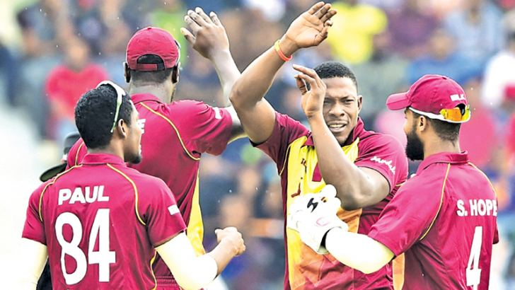 West Indies cricketer Sheldon Cottrell (2R) celebrates with his teammates after the dismissal of the Bangladeshi cricketer Tamim Iqbal during the first Twenty20 (T20) cricket match between Bangladesh and West Indies at the Sylhet International Cricket Stadium in Sylhet on December 17. AFP