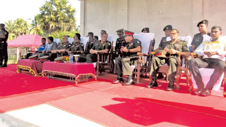 Guests Army officials watching a training session
